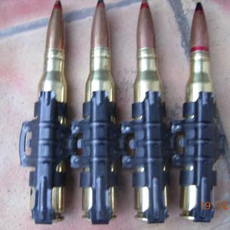 Ммг патроны с крупнокалиберного пулемета 12.7 мм.в ленте.деактивированы.