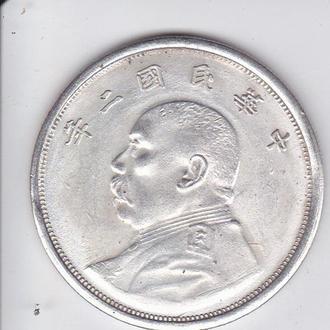 монета Китаю