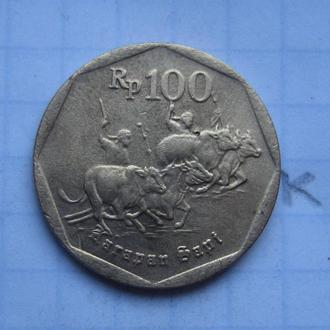 Индонезия, 100 рупий 1994 г. (ПОГОНЩИКИ БУЙВОЛОВ).