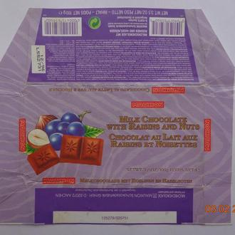 "Обёртка от шоколада ""Milk with raisins and nuts"" (Mauxion Schokoladefabrik, Aachen, Германия) (1996)"