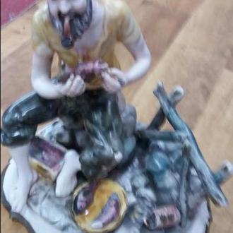 фарфорова статуетка.рибак