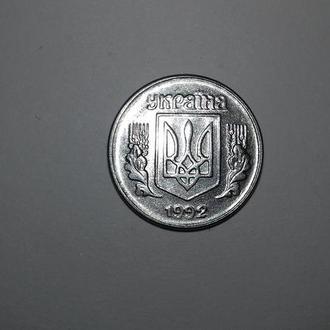 Украинская монета номиналом 1 копейка 1992 года выпуска