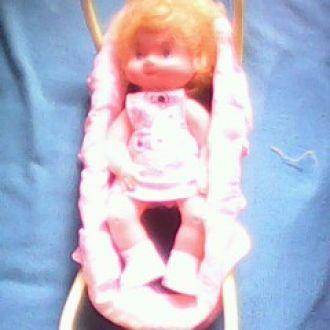 игрушка кукла в люльке