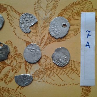 7 Серебрянных  средневековых арабских монет.