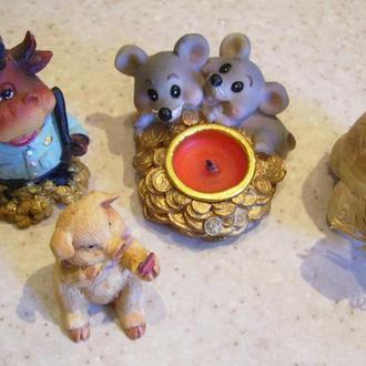 3 фигурки и свечка
