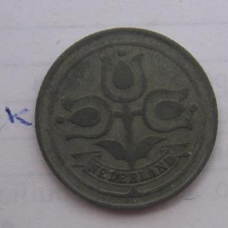 НИДЕРЛАНДЫ. 10 центов 1942 года (ТЮЛЬПАНЫ).