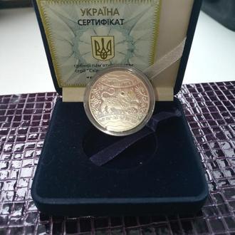 Монета серебряная номиналом 5 грн.год тигра.восточный