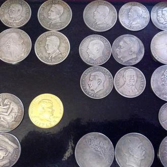 Немного гитлеров. Последнее фото - крымская монета 3 рейха.