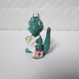"""Динозавр медсестра, серия """"Динозавры-строители"""" 1994 года"""