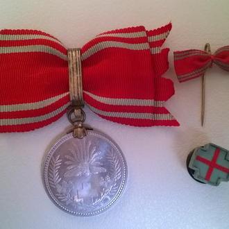 Медаль за ранение на женщину. Япония