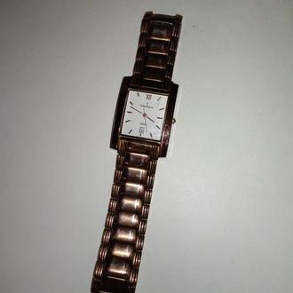 Часы Романсон.