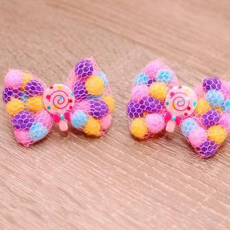 Маленькие яркие резиночки с помпонами