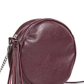 Стильная круглая сумка из натуральной кожи