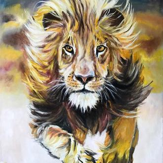 Біжить лев