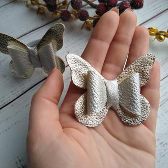 Бабочка из экокожи на резинке