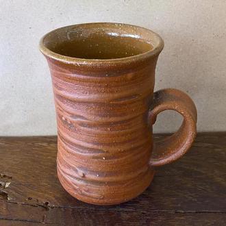 Керамическая гончарная чашка.
