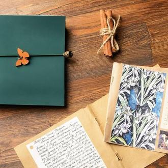 Зеленый блокнот с бабочкой