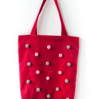 Розовая текстильная сумка с помпонами