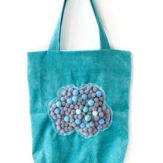 Бирюзовая текстильная сумка с помпонами