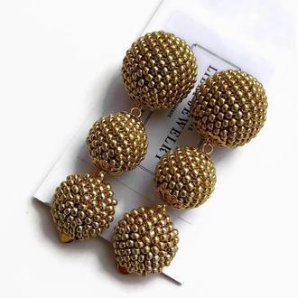 Золотистые серьги-клипсы из бисера Бон Бон