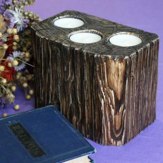 Массивный деревянный подсвечник