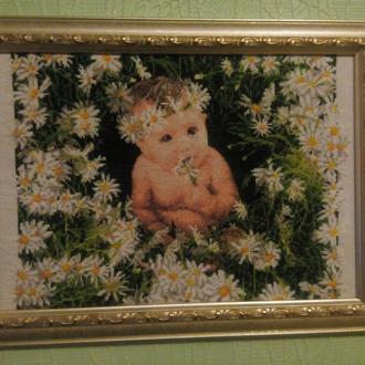 Младенец в ромашках
