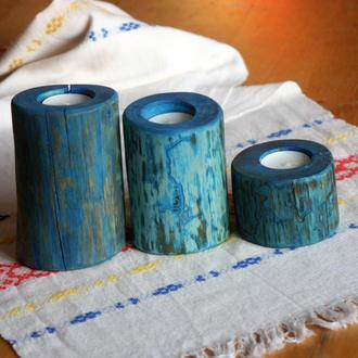 Набор из трех деревянных подсвечников синего цвета