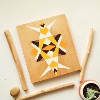 Панно в этно стиле, с геометрическим рисунком.