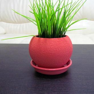 Искусственная трава в горшке розового цвета