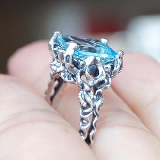 Серебряное кольцо с натуральным топазом огранки октагон