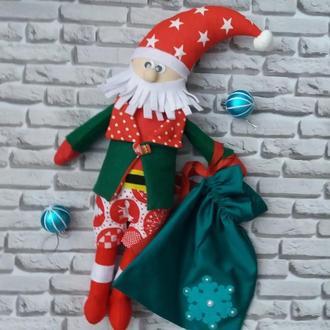 Санта Клаус с мешочком под подарок