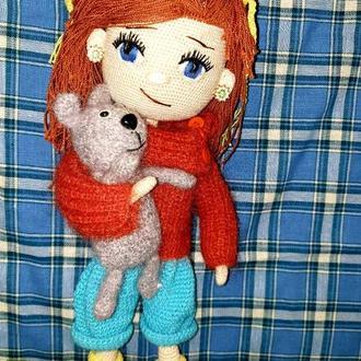 Куколка с собачкой.