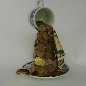 Золотая денежная кружка