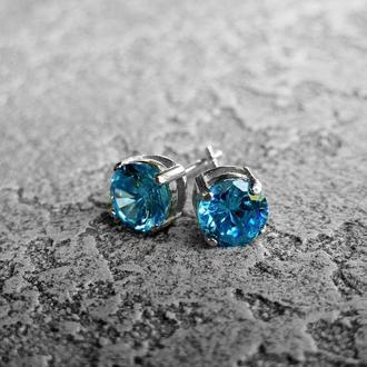 Серебряные серьги-пуссеты с голубым цирконом
