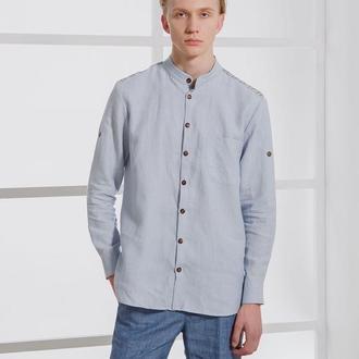 Рубашка голубого цвета с вышивкой на плечах