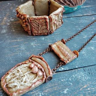 комплект украшений из браслета и кулона