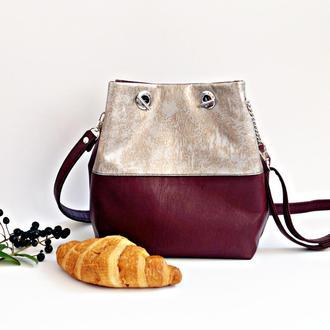 Бордово-золотая сумка-мешок через плечо из эко-кожи