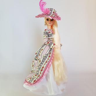 Лялька блондинка з довгими волоссям в рожевому бальній сукні