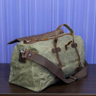 Дорожная сумка из водонепроницаемого вощеного канваса и натуральной кожи.