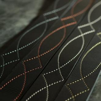 черный кожаный ремень с фигурной строчкой