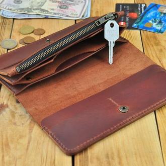 Вместительное портмоне для всего необходимого с отдельными карманами