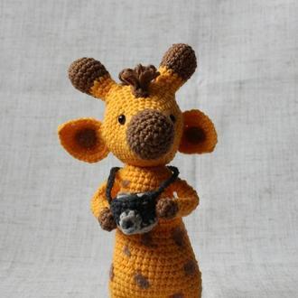 Игрушка жираф с фотоаппаратом