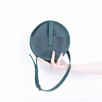 Элегантная кожаная поясная сумка круглой формы зеленый