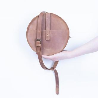 Элегантная кожаная поясная сумка круглой формы