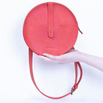 Элегантная кожаная поясная сумка круглой формы красный