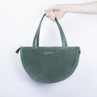 Вечерняя женская сумочка, сделанная из натуральной кожи зеленый
