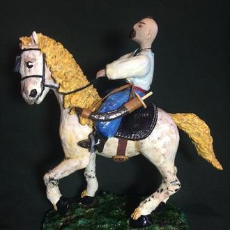 Козак с саблей на лошади