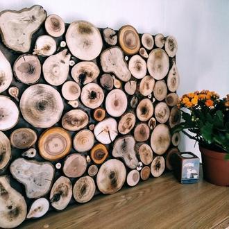 Панно из крупных деревянных срубов