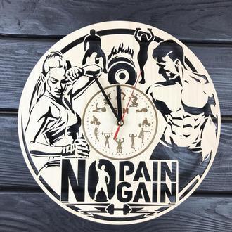 Тематичні настінні годинники з дерева в спортзал