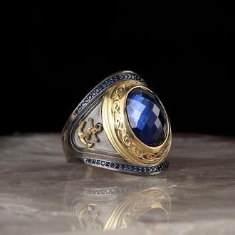 Авторитетное кольцо  из серебра с синим цирконом Гравировка якорь